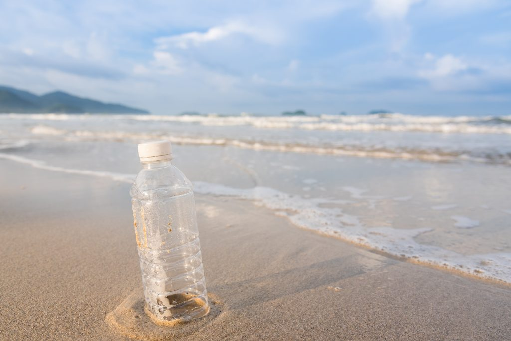 Close-Up Of Bottle On Beach